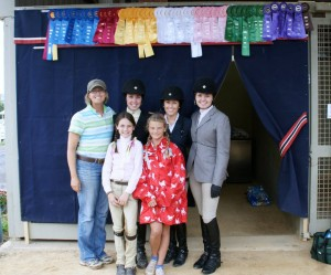 Clairvaux Riders and Terri in front of our tack stall and banner at Lexington National 2010 / VHSA Medal Finals