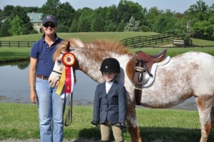 Ashley Schneider and Caramel Topping showing off their Reserve Champion ribbon.